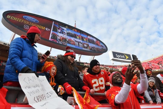 Jan 6, 2018; Kansas City, MO, USA; Kansas City Chiefs outside linebacker Tamba Hali (91) takes a selfie photo with fans before the AFC Wild Card playoff football game against the Tennessee Titans at Arrowhead Stadium. Mandatory Credit: Jerry Lai-USA TODAY Sports