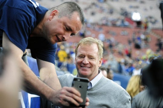 January 6, 2018; Los Angeles, CA, USA; NFL commissioner Roger Goodell takes a picture with a fan before the Los Angeles Rams play against the Atlanta Falcons in the NFC Wild Card playoff football game at the Los Angeles Memorial Coliseum. Mandatory Credit: Gary A. Vasquez-USA TODAY Sports