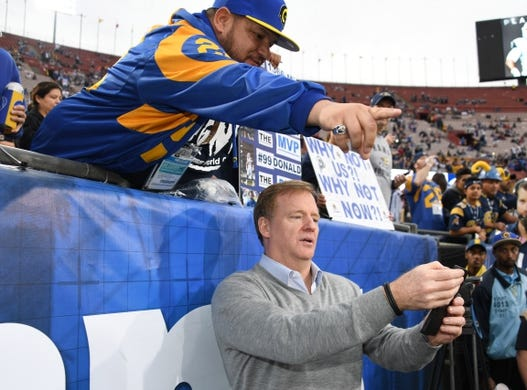 Jan 6, 2018; Los Angeles, CA, USA; NFL commissioner Roger Goodell poses for selfie with fans at the NFC Wild Card playoff football game between the Los Angeles Rams and the Atlanta Falcons at Los Angeles Memorial Coliseum. Mandatory Credit: Kirby Lee-USA TODAY Sports