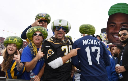 Jan 6, 2018; Los Angeles, CA, USA; Los Angeles Rams fans pose with watermelons on their heads at the NFC Wild Card playoff football game against the Atlanta Falcons at Los Angeles Memorial Coliseum. Mandatory Credit: Kirby Lee-USA TODAY Sports