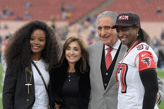 Jan 6, 2018; Los Angeles, CA, USA; Loreal Smith (left), Angela Macuga (second from left), Atlanta Falcons owner Arthur Blank (second from right) and Elisha Arrett pose prior to the NFC Wild Card playoff football game at Los Angeles Memorial Coliseum. Macuga is the wife of Blank and Jarrett is the mother of defensive tackle Grady Jarrett. Mandatory Credit: Kirby Lee-USA TODAY Sports