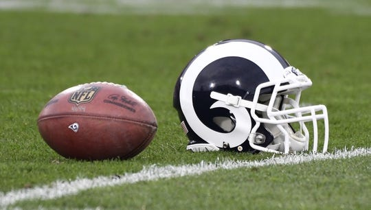Jan 6, 2018; Los Angeles, CA, USA; Detail view of a football and a Los Angeles Rams helmet on the field before the NFC Wild Card playoff football game between the Los Angeles Rams and the Atlanta Falcons at Los Angeles Memorial Coliseum. Mandatory Credit: Robert Hanashiro-USA TODAY Sports