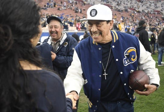 Jan 6, 2018; Los Angeles, CA, USA; American actor Danny Trejo shakes hands with fans before the NFC Wild Card playoff football game between the Los Angeles Rams and the Atlanta Falcons at Los Angeles Memorial Coliseum. Mandatory Credit: Robert Hanashiro-USA TODAY Sports