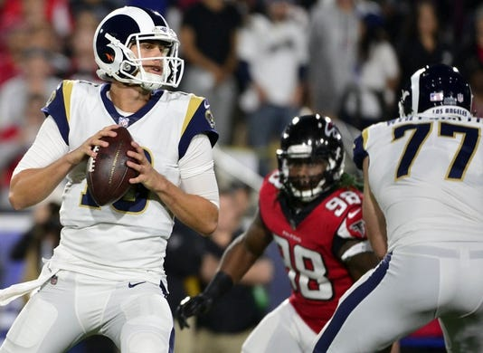 January 6, 2018; Los Angeles, CA, USA; Los Angeles Rams quarterback Jared Goff (16) drops back to pass as Atlanta Falcons defensive end Takkarist McKinley (98) moves in during the first half in the NFC Wild Card playoff football game at the Los Angeles Memorial Coliseum. Mandatory Credit: Gary A. Vasquez-USA TODAY Sports