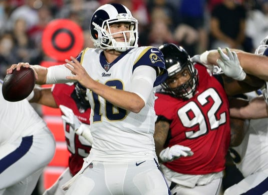 January 6, 2018; Los Angeles, CA, USA; Los Angeles Rams quarterback Jared Goff (16) drops back to pass as Atlanta Falcons defensive tackle Dontari Poe (92) moves in during the first half in the NFC Wild Card playoff football game at the Los Angeles Memorial Coliseum. Mandatory Credit: Gary A. Vasquez-USA TODAY Sports