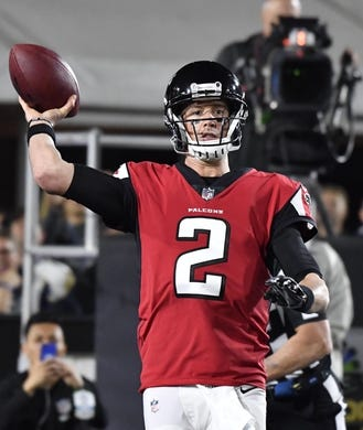 Jan 6, 2018; Los Angeles, CA, USA; Atlanta Falcons quarterback Matt Ryan (2) passes against the Los Angeles Rams in the first quarter in the NFC Wild Card playoff football game at Los Angeles Memorial Coliseum. Mandatory Credit: Robert Hanashiro-USA TODAY Sports