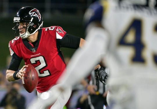 January 6, 2018; Los Angeles, CA, USA; Atlanta Falcons quarterback Matt Ryan (2) runs the ball against the Los Angeles Rams during the first half in the NFC Wild Card playoff football game at the Los Angeles Memorial Coliseum. Mandatory Credit: Gary A. Vasquez-USA TODAY Sports