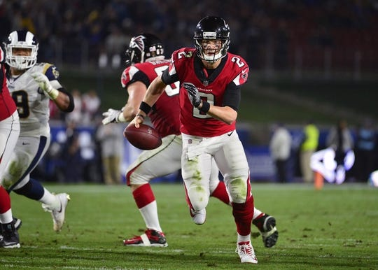 January 6, 2018; Los Angeles, CA, USA; Atlanta Falcons quarterback Matt Ryan (2) runs the ball against the /Los Angeles Rams during the first half in the NFC Wild Card playoff football game at the Los Angeles Memorial Coliseum. Mandatory Credit: Gary A. Vasquez-USA TODAY Sports