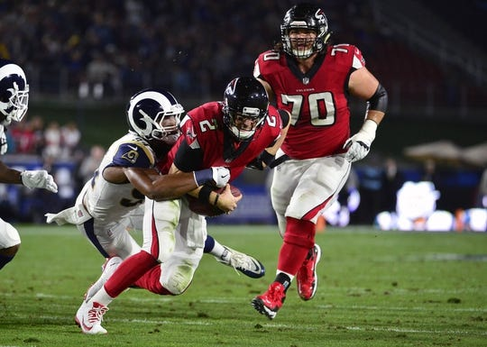 January 6, 2018; Los Angeles, CA, USA; Atlanta Falcons quarterback Matt Ryan (2) is brought down by Los Angeles Rams outside linebacker Robert Quinn (94) during the first half in the NFC Wild Card playoff football game at the Los Angeles Memorial Coliseum. Mandatory Credit: Gary A. Vasquez-USA TODAY Sports