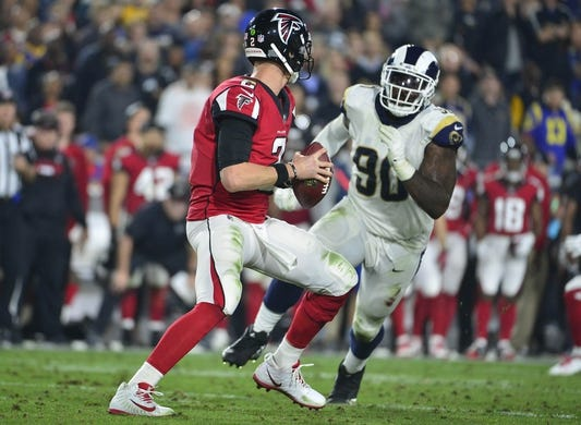 January 6, 2018; Los Angeles, CA, USA; Atlanta Falcons quarterback Matt Ryan (2) moves out to pass as Los Angeles Rams nose tackle Michael Brockers (90) puts pressure during the first half in the NFC Wild Card playoff football game at the Los Angeles Memorial Coliseum. Mandatory Credit: Gary A. Vasquez-USA TODAY Sports