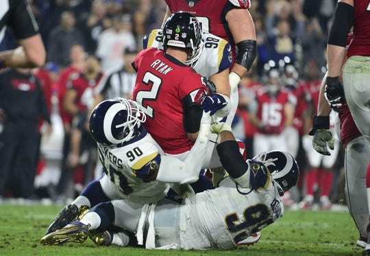 January 6, 2018; Los Angeles, CA, USA; Atlanta Falcons quarterback Matt Ryan (2) is brought down by Los Angeles Rams nose tackle Michael Brockers (90) and defensive end Aaron Donald (99) during the first half in the NFC Wild Card playoff football game at the Los Angeles Memorial Coliseum. Mandatory Credit: Gary A. Vasquez-USA TODAY Sports