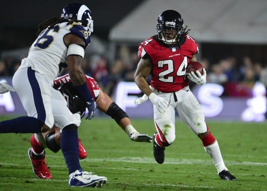 January 6, 2018; Los Angeles, CA, USA; Atlanta Falcons running back Devonta Freeman (24) runs the ball against the Los Angeles Rams during the first half in the NFC Wild Card playoff football game at the Los Angeles Memorial Coliseum. Mandatory Credit: Gary A. Vasquez-USA TODAY Sports