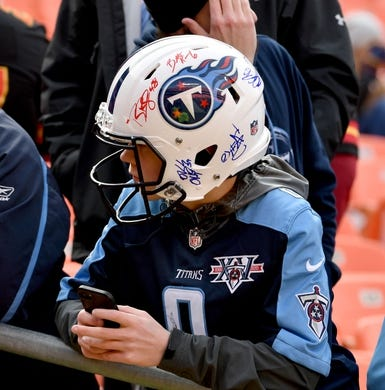 Jan 6, 2018; Kansas City, MO, USA; A Tennessee Titans fan wears his autographed helmet before the game against the Kansas City Chiefs in the AFC Wild Card playoff football game at Arrowhead stadium. Mandatory Credit: Denny Medley-USA TODAY Sports