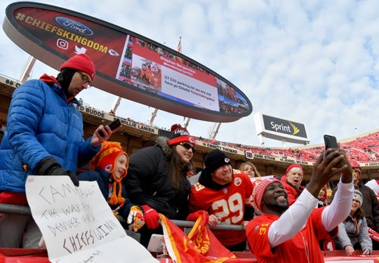 Jan 6, 2018; Kansas City, MO, USA; Kansas City Chiefs outside linebacker Tamba Hali (91) takes selfies with fans before the game against the Tennessee Titans in the AFC Wild Card playoff football game at Arrowhead stadium. Mandatory Credit: Denny Medley-USA TODAY Sports