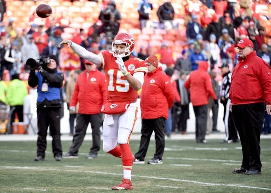 Jan 6, 2018; Kansas City, MO, USA; Kansas City Chiefs quarterback Patrick Mahomes (15) warms up as head coach Andy Reid watches before the game against the Tennessee Titans in the AFC Wild Card playoff football game at Arrowhead stadium. Mandatory Credit: Denny Medley-USA TODAY Sports