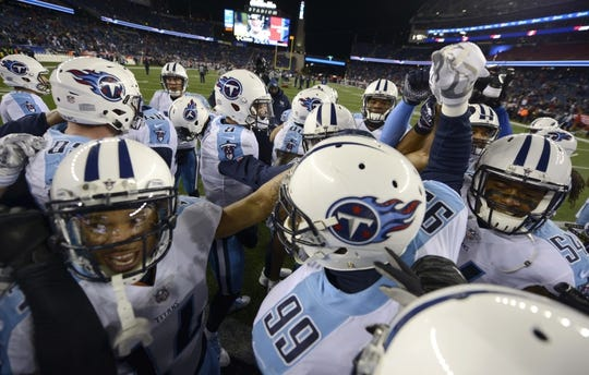 Jan 13, 2018; Foxborough, MA, USA; Tennessee Titans players huddle before the AFC Divisional Playoff game against the New England Patriots at Gillette Stadium. Mandatory Credit: George Walker IV /The Tennessean via USA TODAY NETWORK