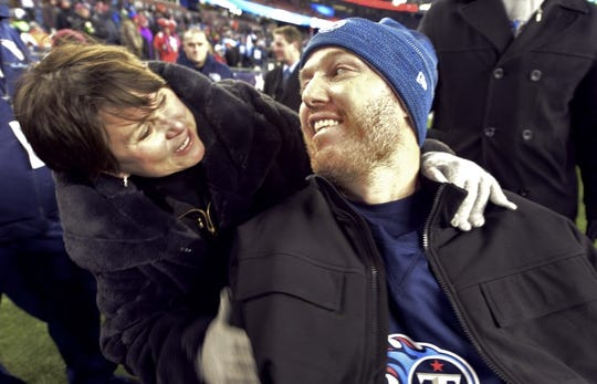 Jan 13, 2018; Foxborough, MA, USA; Tennessee Titans owner Amy Adams Strunk (left) hugs former Titans player Tim Shaw before the AFC Divisional Playoff game against the New England Patriots at Gillette Stadium. Mandatory Credit: George Walker IV /The Tennessean via USA TODAY NETWORK