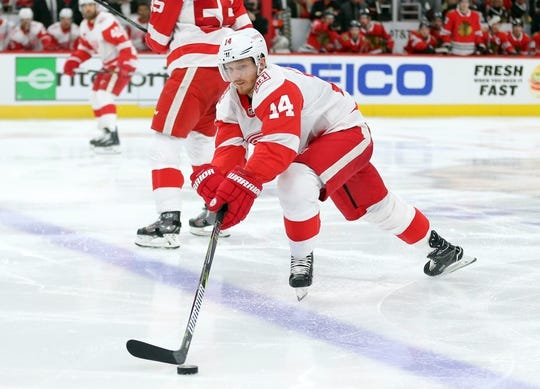 Jan 14, 2018; Chicago, IL, USA; Detroit Red Wings center Gustav Nyquist (14) crosses the blue line during the second period against the Chicago Blackhawks at the United Center. Mandatory Credit: Dennis Wierzbicki-USA TODAY Sports