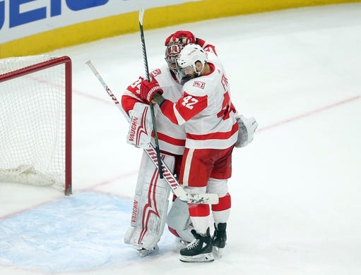 Jan 14, 2018; Chicago, IL, USA; Detroit Red Wings goalie Petr Mrazek (34) celebrates with right wing Martin Frk (42) following the third period against the Chicago Blackhawks at the United Center. Detroit won 4-0. Mandatory Credit: Dennis Wierzbicki-USA TODAY Sports