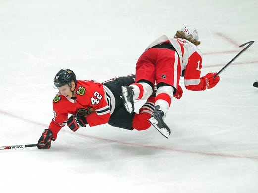 Jan 14, 2018; Chicago, IL, USA; Chicago Blackhawks defenseman Gustav Forsling (42) collides with Detroit Red Wings left wing David Booth (17) during the third period at the United Center. Detroit won 4-0. Mandatory Credit: Dennis Wierzbicki-USA TODAY Sports