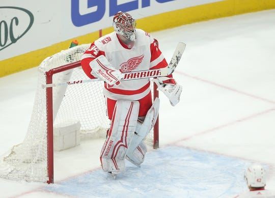 Jan 14, 2018; Chicago, IL, USA; Detroit Red Wings goalie Petr Mrazek (34) reacts after getting a shut out following the third period against the Chicago Blackhawks at the United Center. Detroit won 4-0. Mandatory Credit: Dennis Wierzbicki-USA TODAY Sports