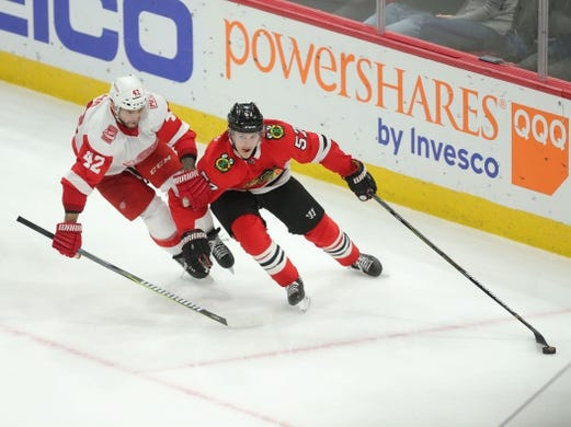 Jan 14, 2018; Chicago, IL, USA; Chicago Blackhawks center Tommy Wingels (57) and Detroit Red Wings right wing Martin Frk (42) fight for the puck during the third period at the United Center. Detroit won 4-0. Mandatory Credit: Dennis Wierzbicki-USA TODAY Sports
