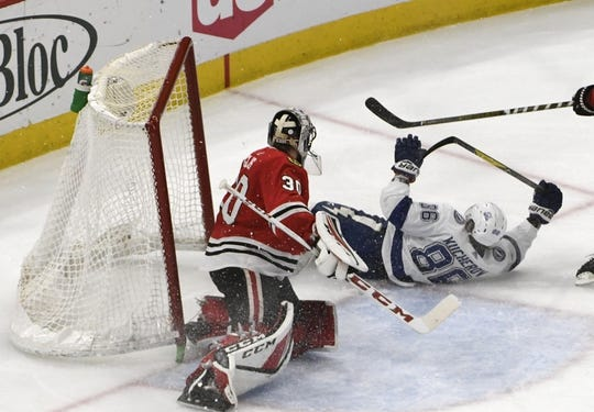 Jan 22, 2018; Chicago, IL, USA; Tampa Bay Lightning right wing Nikita Kucherov (86) crashes into the net as Chicago Blackhawks goaltender Jeff Glass (30) watches during the second period at United Center. Mandatory Credit: David Banks-USA TODAY Sports