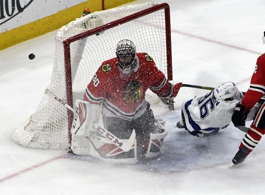 Jan 22, 2018; Chicago, IL, USA; Tampa Bay Lightning right wing Nikita Kucherov (86) shoots the puck past Chicago Blackhawks goaltender Jeff Glass (30) during the second period at United Center. Mandatory Credit: David Banks-USA TODAY Sports