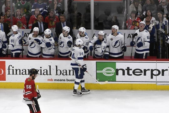 Jan 22, 2018; Chicago, IL, USA; Tampa Bay Lightning left wing Chris Kunitz (14) celebrates with his teammates after scoring a goal against the Chicago Blackhawks during the second period at United Center. Mandatory Credit: David Banks-USA TODAY Sports