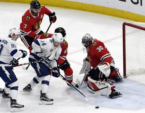 Jan 22, 2018; Chicago, IL, USA; Tampa Bay Lightning left wing Chris Kunitz (14) shoots on Chicago Blackhawks goaltender Jeff Glass (30) during the third period at United Center. Mandatory Credit: David Banks-USA TODAY Sports