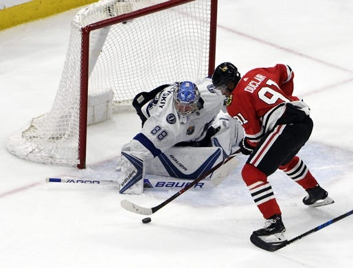 Jan 22, 2018; Chicago, IL, USA;  Tampa Bay Lightning goaltender Andrei Vasilevskiy (88) makes save on Chicago Blackhawks left wing Anthony Duclair (91) during the third period at United Center. Mandatory Credit: David Banks-USA TODAY Sports