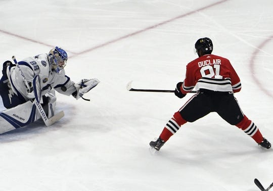 Jan 22, 2018; Chicago, IL, USA;  Tampa Bay Lightning goaltender Andrei Vasilevskiy (88) makes a save on Chicago Blackhawks left wing Anthony Duclair (91) during the third period at United Center. Mandatory Credit: David Banks-USA TODAY Sports