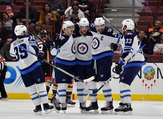 January 25, 2018; Anaheim, CA, USA; Winnipeg Jets right wing Patrik Laine (29) celebrates his goal scored against the Anaheim Ducks during the first period at Honda Center. Mandatory Credit: Gary A. Vasquez-USA TODAY Sports
