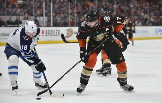 January 25, 2018; Anaheim, CA, USA; Anaheim Ducks center Ryan Kesler (17) plays for the puck against Winnipeg Jets center Bryan Little (18) during the first period at Honda Center. Mandatory Credit: Gary A. Vasquez-USA TODAY Sports
