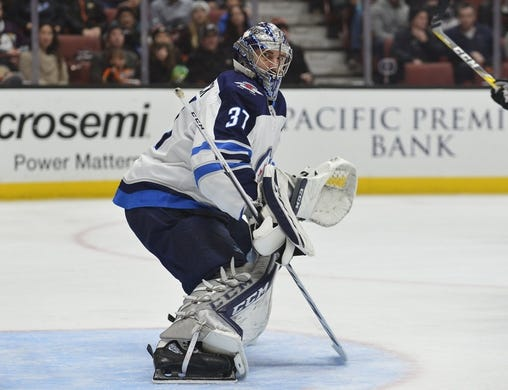 January 25, 2018; Anaheim, CA, USA; Winnipeg Jets goaltender Connor Hellebuyck (37) defends the goal against the Anaheim Ducks during the first period at Honda Center. Mandatory Credit: Gary A. Vasquez-USA TODAY Sports