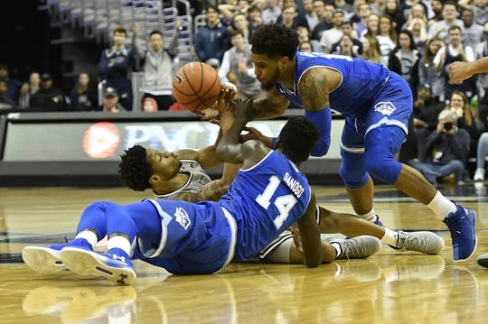 Feb 10, 2018; Washington, DC, USA;  Georgetown Hoyas guard Jahvon Blair (0) scrambles for a loose ball with Seton Hall Pirates forward Ismael Sanogo (14) and guard Myles Powell (13) during the first half at Capital One Arena. Mandatory Credit: Tommy Gilligan-USA TODAY Sports