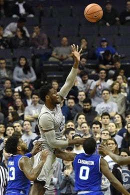 Feb 10, 2018; Washington, DC, USA;  Georgetown Hoyas center Jessie Govan (15) shoots as Seton Hall Pirates guard Myles Powell (13) and Seton Hall Pirates guard Khadeen Carrington (0) defends during the first half at Capital One Arena. Mandatory Credit: Tommy Gilligan-USA TODAY Sports
