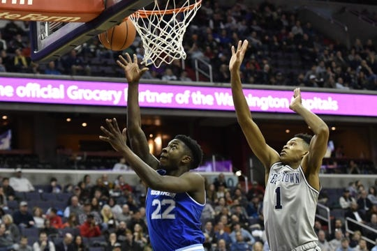Feb 10, 2018; Washington, DC, USA; Seton Hall Pirates guard Myles Cale (22) shoots as Georgetown Hoyas forward Jamorko Pickett (1) defends during the first half  at Capital One Arena. Mandatory Credit: Tommy Gilligan-USA TODAY Sports