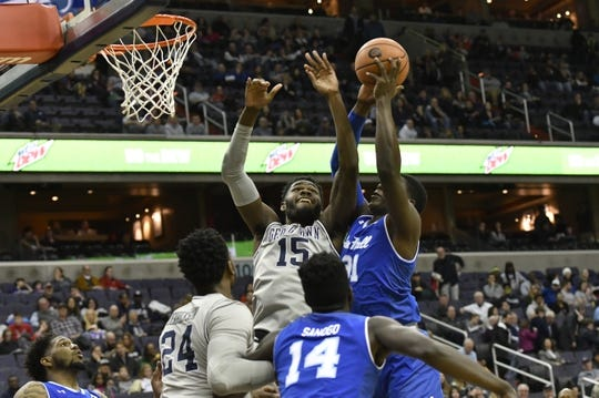 Feb 10, 2018; Washington, DC, USA;  Seton Hall Pirates center Angel Delgado (31) grabs a rebound in front of Georgetown Hoyas center Jessie Govan (15) during the first half at Capital One Arena. Mandatory Credit: Tommy Gilligan-USA TODAY Sports