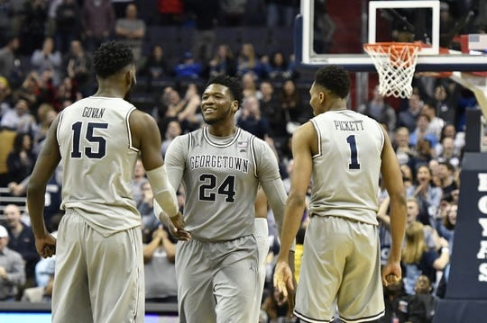 Feb 10, 2018; Washington, DC, USA;  Georgetown Hoyas forward Marcus Derrickson (24) celebrates with  center Jessie Govan (15) and  forward Jamorko Pickett (1) after making the the go ahead three point shot with four seconds to go in the second half against the Seton Hall Pirates at Capital One Arena. Mandatory Credit: Tommy Gilligan-USA TODAY Sports