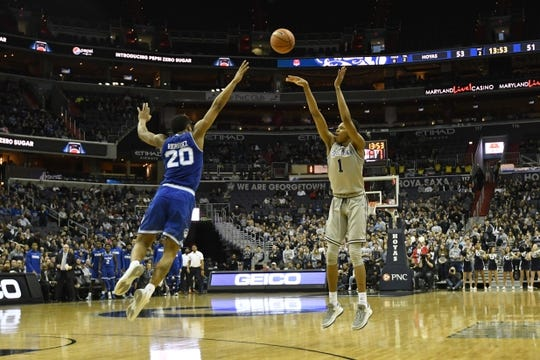Feb 10, 2018; Washington, DC, USA;  Georgetown Hoyas forward Jamorko Pickett (1) shoots a three point shot as Seton Hall Pirates forward Desi Rodriguez (20) closes in to defend during the second half at Capital One Arena. Mandatory Credit: Tommy Gilligan-USA TODAY Sports