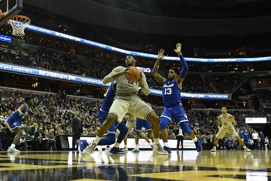 Feb 10, 2018; Washington, DC, USA;  Georgetown Hoyas forward Marcus Derrickson (24) looks to move the ball as Seton Hall Pirates center Angel Delgado (31) and guard Myles Powell (13) defend during the second half at Capital One Arena. Mandatory Credit: Tommy Gilligan-USA TODAY Sports