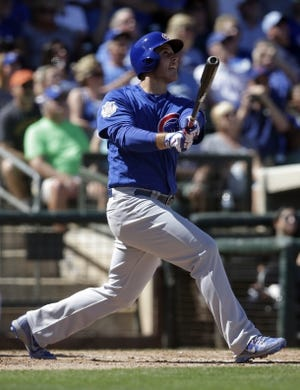 Mar 14, 2018; Surprise, AZ, USA; Chicago Cubs first baseman Anthony Rizzo (44) hits a sacrifice RBI fly out in the third inning against the Kansas City Royals at Surprise Stadium. Mandatory Credit: Rick Scuteri-USA TODAY Sports