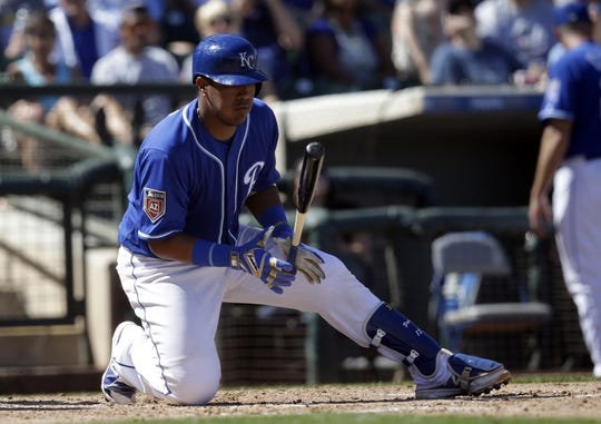 Mar 14, 2018; Surprise, AZ, USA; Kansas City Royals catcher Salvador Perez (13) reacts after missing a pitch against the Chicago Cubs in the fourth inning at Surprise Stadium. Mandatory Credit: Rick Scuteri-USA TODAY Sports
