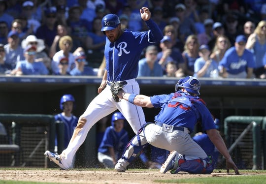 Mar 14, 2018; Surprise, AZ, USA; Chicago Cubs catcher Chris Gimenez (53) tags out Kansas City Royals pitching coach Cal Eldred (21) trying to score in the fourth inning at Surprise Stadium. Mandatory Credit: Rick Scuteri-USA TODAY Sports