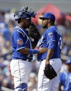 Mar 14, 2018; Surprise, AZ, USA; Kansas City Royals catcher Salvador Perez (13) talks to Wily Peralta (43) in between innings in the fifth inning against the Chicago Cubs wat Surprise Stadium. Mandatory Credit: Rick Scuteri-USA TODAY Sports
