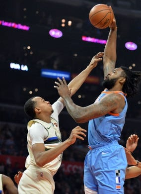 March 27, 2018; Los Angeles, CA, USA; Los Angeles Clippers center DeAndre Jordan (6) moves to the basket against Milwaukee Bucks center John Henson (31) during the first half at Staples Center. Mandatory Credit: Gary A. Vasquez-USA TODAY Sports