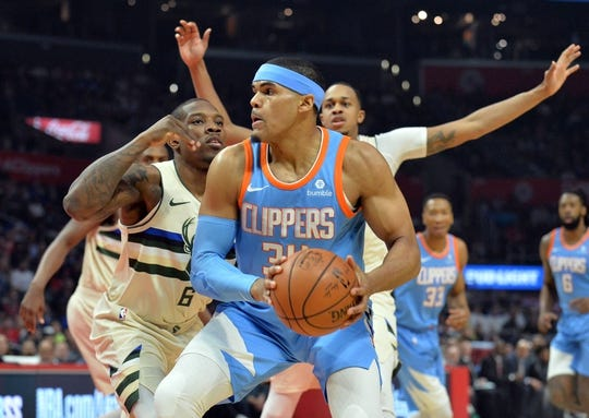March 27, 2018; Los Angeles, CA, USA; Los Angeles Clippers forward Tobias Harris (34) controls the ball against Milwaukee Bucks guard Eric Bledsoe (6) during the first half at Staples Center. Mandatory Credit: Gary A. Vasquez-USA TODAY Sports