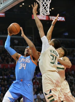 March 27, 2018; Los Angeles, CA, USA; Los Angeles Clippers forward Tobias Harris (34) moves to the basket against Milwaukee Bucks center John Henson (31) and forward Giannis Antetokounmpo (34) during the first half at Staples Center. Mandatory Credit: Gary A. Vasquez-USA TODAY Sports