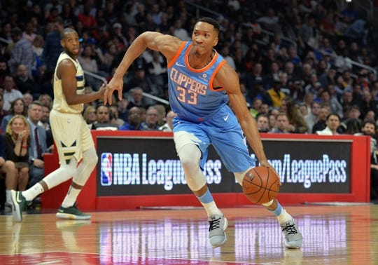 March 27, 2018; Los Angeles, CA, USA; Los Angeles Clippers forward Wesley Johnson (33) moves to the basket against the Milwaukee Bucks during the first half at Staples Center. Mandatory Credit: Gary A. Vasquez-USA TODAY Sports